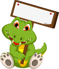 cute baby crocodile holding blank board