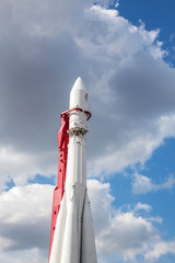 white rocket on blue sky background