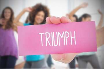Woman holding pink card saying triumph