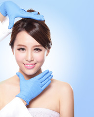 beautiful female face with Plastic surgery glove