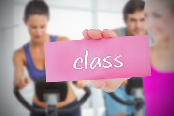 Fit blonde holding card saying class