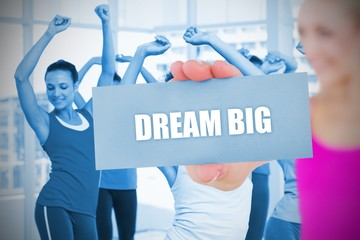 Fit blonde holding card saying dream big