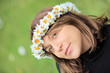 Beautiful woman with daisy hair wreath