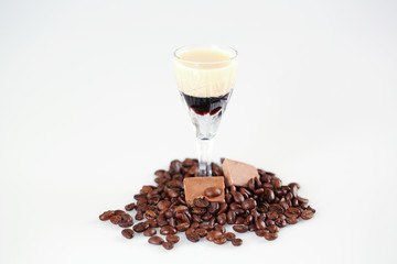Delicious coffee cocktail with coffee beans and chocolate