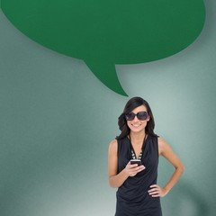 Composite image of happy brunette holding smartphone with speech