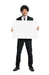 Smiling Man In Tuxedo Holding Placard