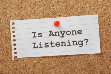 Is Anyone Listening question on a cork notice board