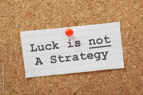 Luck is not a Strategy on a cork notice board as a reminder - 64984761