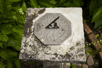 A stone sundial in a park in Dunster, Devon, England