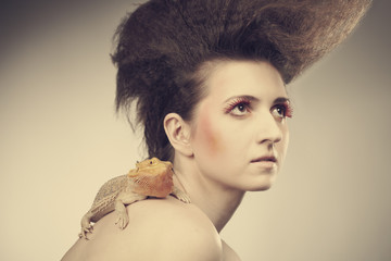 Pretty lady posing with her agama lizard