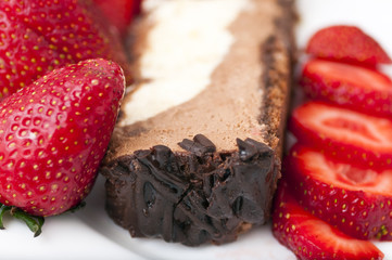close-up of Slice of chocolate cake with strawberries