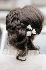Beauty wedding hairstyle with flowers