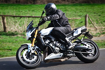 Motorcyclist biker on the road
