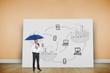 Composite image of happy businessman holding umbrella