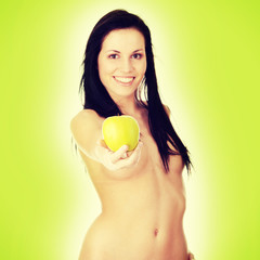 Girl with a green juicy apple