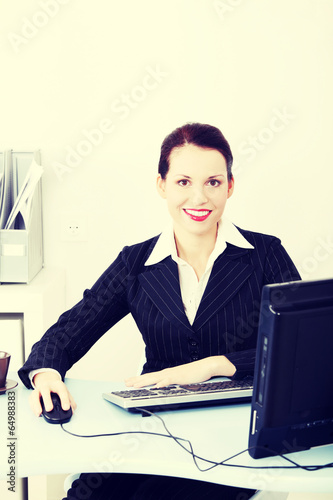 Beautiful business woman in office.
