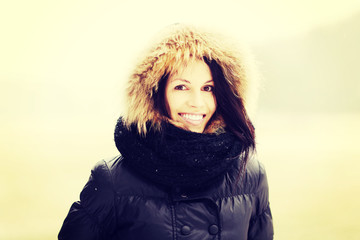Smiling young woman in cold day