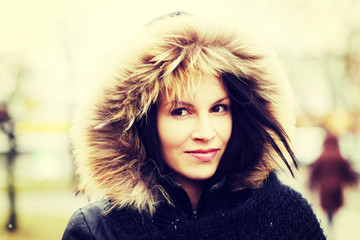 Young woman in furry hood.