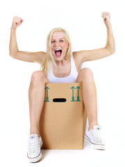 Young woman rests in her moving box and shouts