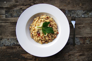 Risotto on rustic table outdoors