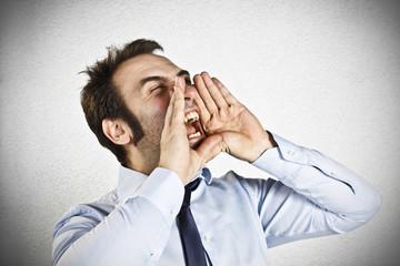 Angry businessman screams