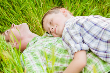 Father and boy in nature summer