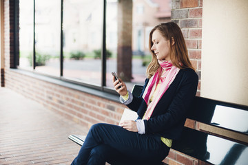 Business woman with smart phone