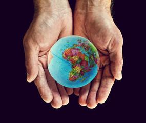 africa globe hands