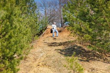 man climbing uphill