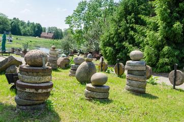 millstones stone figure in meadow landscape park