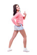 Pretty woman posing in sexy jeans shorts. Isolated on white