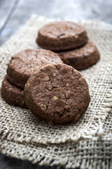 chocolate cookies over wooden background