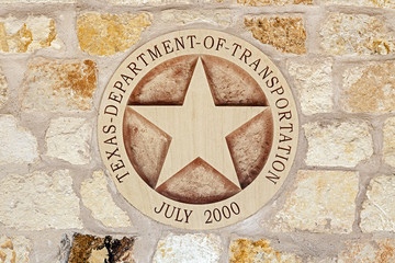 Texas Department of Transportation Symbol on the Sandstone Wall