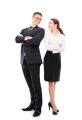 Couple of young business persons posing together on white