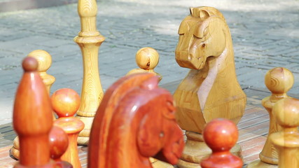 Focus shifting on big wooden chess figures