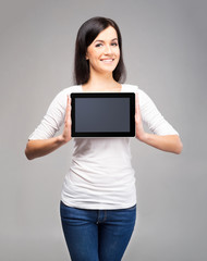 Young and beautiful teenager girl holding an ipad tablet pc