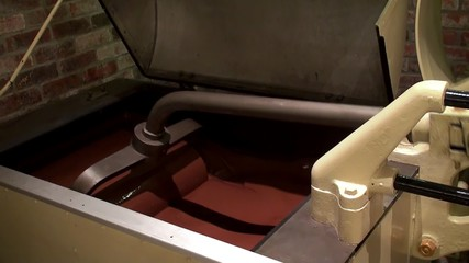 Work of Chocolate Factory. Melanger Mixing mashine.