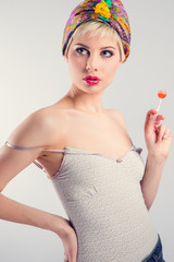 Vintage girl model with lollipop