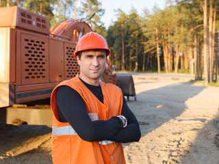 man working in  helmet