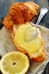 Croissant with cream and lemon.
