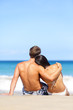 Beach couple romantic in love relaxing on travel