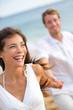 Couple on beach laughing having fun lifestyle