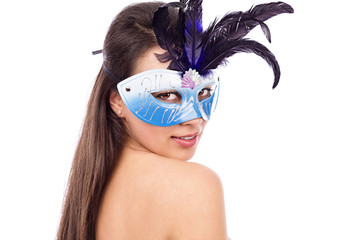 Close-up portrait of sexy brunette woman with carnival  mask