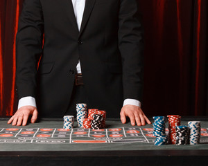 Man placing a bet at the casino