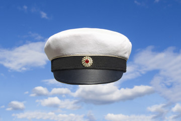 Student cap Swedish on blue sky