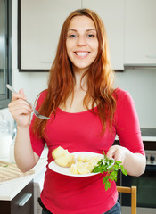 positive   girl eating potatoes