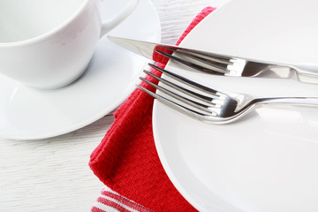 Table setting with red napkins