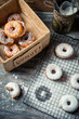 Tasting sweet donuts with icing sugar