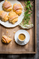 Breakfast in bed with a croissant and flowers