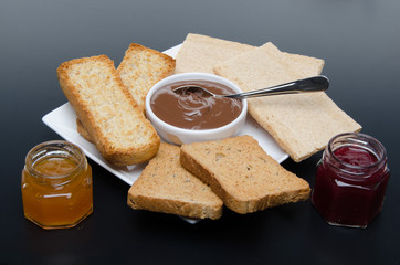 Composition of chocolate hazelnut spread, jams and different rus